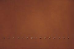 Brown di piastra metallica con i ribattini per il lerciume o il fondo astratto Fotografia Stock Libera da Diritti