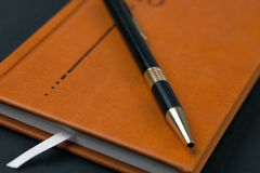 Brown diary and pen Stock Image