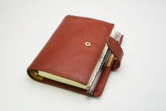 Brown diary with pen Royalty Free Stock Photo