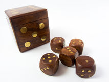 Brown dice. Six brown dice five small one big Royalty Free Stock Images