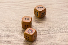 Brown dices on wooden background. Concept of luck, chance and leisure fun./ Sensitive Focus / this dice by handmade royalty free stock images