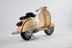 Brown diecast scooter Royalty Free Stock Photos