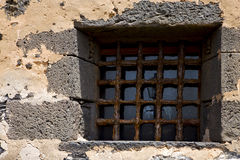 Brown distorted  castle window in a broke   wall arrecife Stock Image