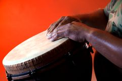 Brown Djembe With Hands Orange Bk Royalty Free Stock Photo