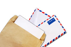 Brown document and air mail envelope isolated Royalty Free Stock Photo