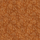 Brown Doggy Tile Pattern Repeat Background. Brown Dog Paw Prints, Puppy, Bone and Hearts Tile Pattern Repeat Background that is seamless and repeats Stock Photo