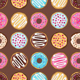 Brown donuts pattern Stock Images