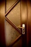 Brown door. With metal handle Stock Images