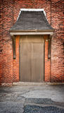 Brown door on brick building Stock Image