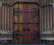 Brown Door 1. Double brown doors within stone framework and surrounding pillars Stock Photo