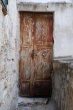 Brown Door in Ostuni Stock Image