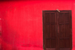 Brown door and red wall. Brown wood door and red wall Royalty Free Stock Photos