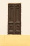 Brown door in the wall Royalty Free Stock Photos