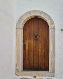 Brown door on white wall Royalty Free Stock Photography
