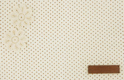 Brown dot cloth as background wih tag Stock Photos