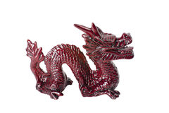 Brown dragon isolated on white background. Brown traditional chinese dragon isolated on white background. Feng Shui statuette Stock Images