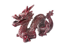 Brown dragon isolated on white background. Brown traditional chinese dragon isolated on white background. Feng Shui statuette Royalty Free Stock Images