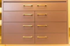 Brown drawers. Practical brown display drawers with metallic handles Royalty Free Stock Images