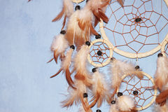 A brown Dreamcatcher. On a blue background Royalty Free Stock Images