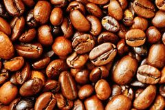Brown dry roasted coffee beans