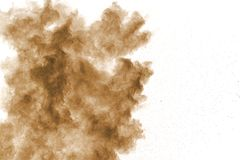 Brown dust cloud.Brown particles splattered on white background stock photos