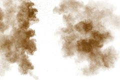 Brown dust cloud.Brown particles splattered on white background royalty free stock images