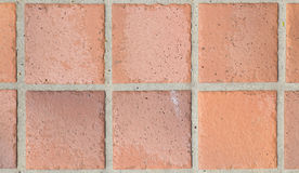 Brown earthenware floor tile seamless background Stock Images