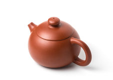Brown earthenware teapot with closed lid isolated on white royalty free stock image