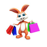 Brown Easter bunny with bags Royalty Free Stock Image