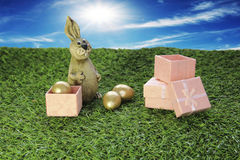 Brown Easter Bunny with pink gift box Royalty Free Stock Photo