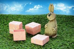 Brown Easter Bunny with pink gift box Stock Image