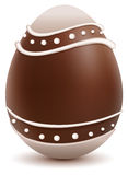 Brown Easter egg decorated with white chocolate Stock Images