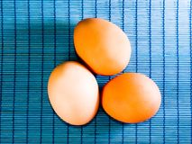 Brown easter eggs on blue bamboo background Royalty Free Stock Photography