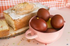 Brown Easter eggs in a plate, Easter cake royalty free stock photography