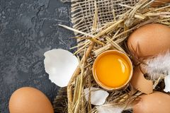 Brown Easter eggs  in a Wicker basket with straw Royalty Free Stock Image