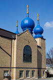 Brown Eastern Orthodox Church with Blue Minarets Royalty Free Stock Images