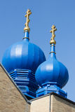 Brown Eastern Orthodox Church with Blue Minarets Stock Photo