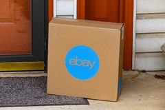 Brown eBay Box at Front Door. Lancaster, PA, USA - December 4, 2017: An ebay package delivered at a front residential door Stock Photos