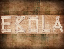 Brown ebola word on grunge wooden plank Stock Photos