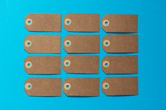 Brown eco label with kraft carton on a blue background. Mockup. Stock Image