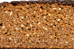 Brown ecological bread slice with grains Royalty Free Stock Photos