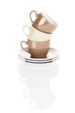 Brown e tazze di caffè cucite con punti metallici beige Immagine Stock
