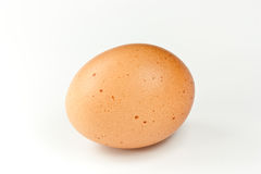 Brown egg. A brown egg isolated on white background Stock Photo