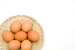 Brown egg. On the bamboo sieve Royalty Free Stock Photos