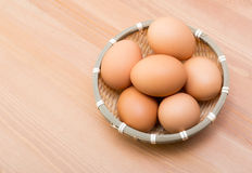 Brown egg in basket Royalty Free Stock Photos