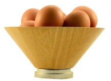 Brown egg. Eggs on the wooden bowl Stock Image