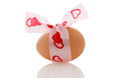 Brown egg with  a  ribbon Stock Image