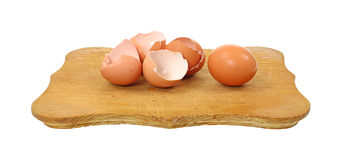Brown egg shells and egg Royalty Free Stock Photo