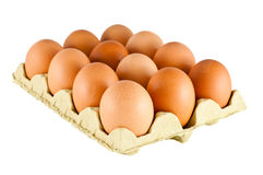 Brown eggs. On carton over white background Stock Photography