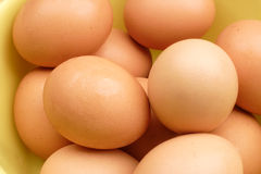 Brown eggs. Close-up of brown eggs piled high stock images